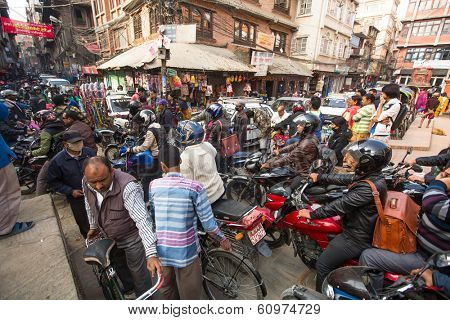 KATHMANDU, NEPAL - DEC 1, 2013: Traffic jam in one of a busy street in the city center. With an area of ??50.67 km in Kathmandu city is home to more than 1 million people.