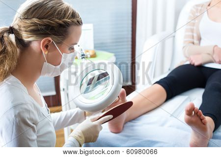 Woman receiving podiatry treatment in a Day Spa