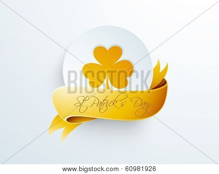 Happy St. Patrick's Day celebrations sticker, tag or label decorated by orange clover leaf with orange ribbon on grey background.