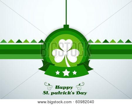 Happy St. Patrick's Day celebrations concept with sticker, tag or label with beautiful shamrock leaf on grey background.
