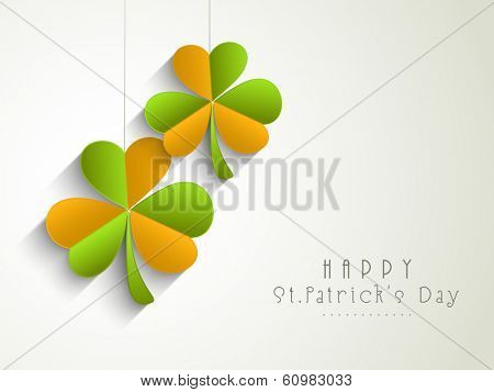 Happy St. Patrick's Day celebrations concept with hanging colorful shamrock leaves on grey background, can be use as sticker, tag or icon.