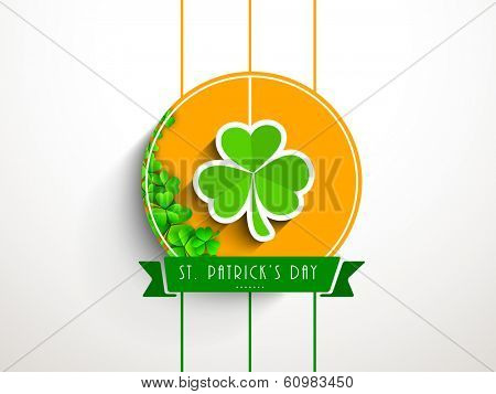Happy St. Patrick's Day celebrations sticker, tag or label design decorated with green irish lucky shamrock leaves on orange, grey background.