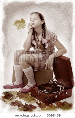 Kid Sitting Holding Maple Leaf With Gramophone