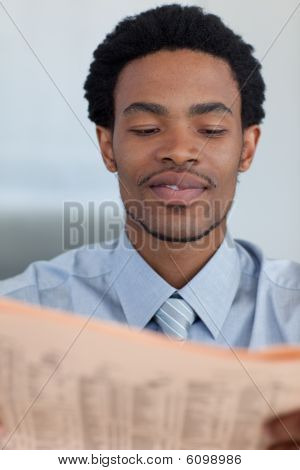 Afro-american Businessman Reading A Newspaper