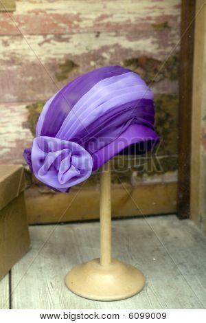 hat on mannequin at window shop