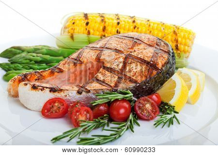 grilled salmon steak with vegetables corn and asparagus