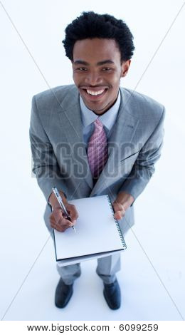 Businessman Writing Notes In A Notebook