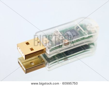 usb flash drive on white glass surface