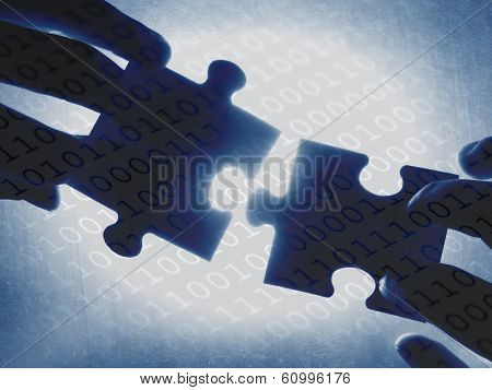 hands trying to fit two puzzle pieces together, on a binary code background