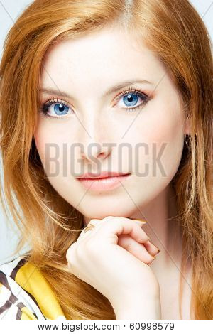 close up studio shot of young beautiful readhead woman