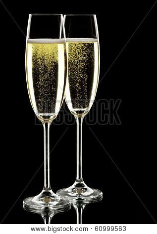 two glasses of sparkling wine, over black, studio shot