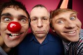 stock photo of fools  - Three april fools looking at camera with different expressions - JPG