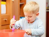 Boy Kid Baking Cake. Child Beating Dough With Wire Whisk. Kitchen.