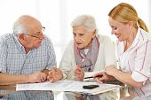 Senior citizens couple argueing over a contract with financial advisor