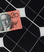 stock photo of twenty dollars  - Solar Panels and Australian twenty dollar note demostrating the link between solar generation and electricity bills - JPG