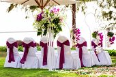 image of marriage ceremony  - view of decorated chairs ready for wedding ceremony - JPG