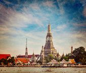 Vintage retro hipster style travel image of Buddhist temple (wat) Wat Arun on Chao Phraya River with