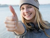 Happy Young Woman Showing Thumb