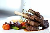 stock photo of lamb chops  - Grilled lamb carre with warm couscous salad - JPG