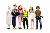 A group of children dressed in costumes of different professions. Isolated over white.