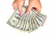 stock photo of twenty dollars  - Dollars in female hands isolated over white - JPG