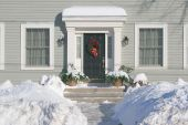stock photo of front door  - The front door of a residential family home decorated with a Christmas wreath - JPG