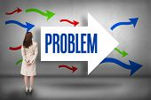 The word problem and rear view of businesswoman against arrows pointing