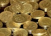 foto of bartering  - A collection of pound coins.