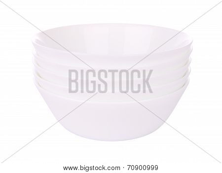 Five round ceramic bowls stack on white background.