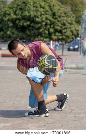 Young man juggling the ball.