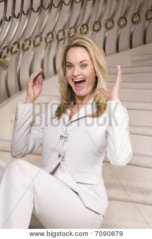 Happy Woman On Stairs