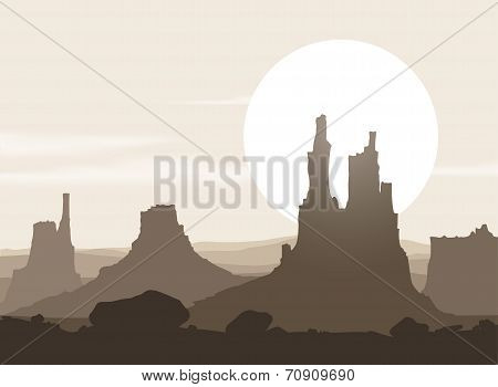Lifeless landscape with mountains over sunset.