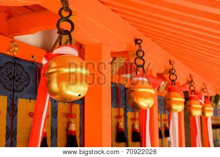 Japanese temple bells in Fushimi Inari Taisha Shrine, Kyoto, Japan.
