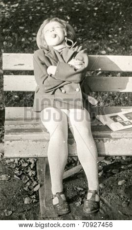 Vintage photo of little girl sticking her tongue out (fifties)