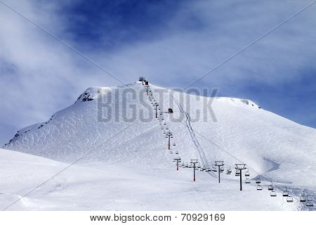 Ski Slope And Chair-lift At Morning
