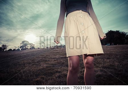 The Skirt Of A Woman Blowing In The Wind At Sunset
