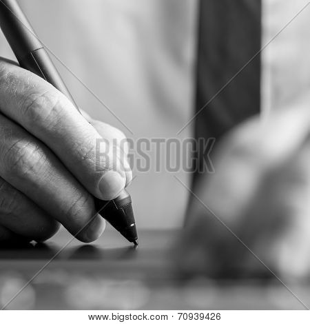 Graphic Designer Working On His Digital Tablet