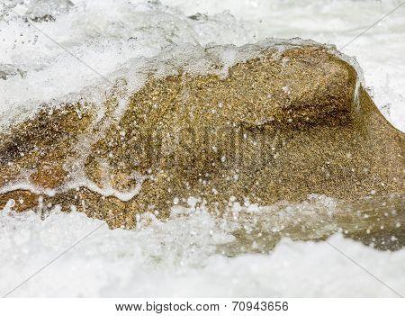 Sharp Simple Shot Of Water Over Rock