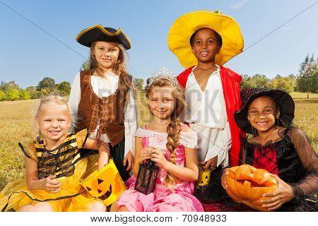 Multinational kids in Halloween costumes