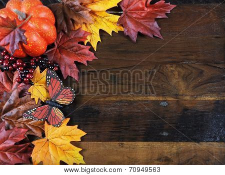 Autumn Fall Background With Red, Brown And Yellow Leaves, Orange Pumpkin And Monarch Butterfly On Da