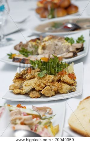 Delicious festive dishes with silverware and glass stemware for an event party