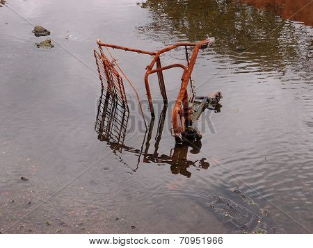 Rusting Shopping Cart In The River