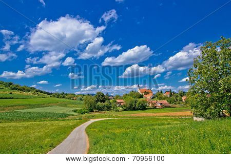 Idyllic Village In Green Nature