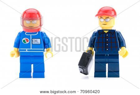 Ankara, Turkey - April 04, 2012 : Lego mechanic and car racer minifigures isolated on white background
