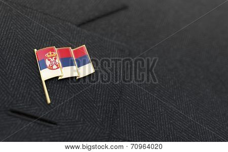 Serbia Flag Lapel Pin On The Collar Of A Business Suit