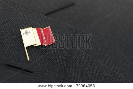 Malta Flag Lapel Pin On The Collar Of A Business Suit
