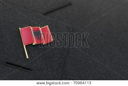 Albania Flag Lapel Pin On The Collar Of A Business Suit