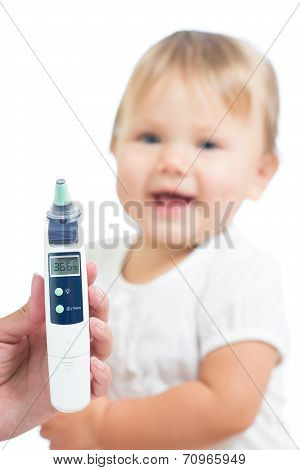 Thermometer Displaying 36,6 Celsius Degrees On Defocused Happy Kid Background. Concept Of Healthy Ba