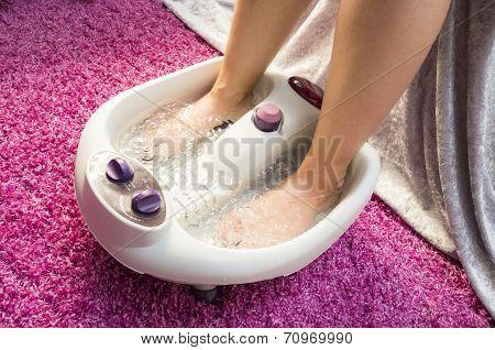 Foot bath massage in a spa center