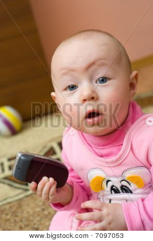 Surprised Baby With Cell Phone